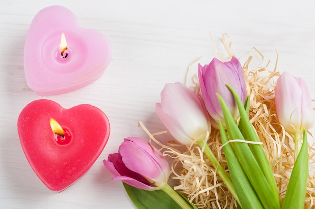 Red pink heart candles and tulips