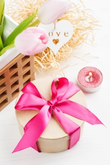 Red pink yellow tulips and gift box with red ribbon