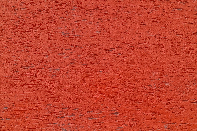 Red plaster wall of a building. rough surface texture.