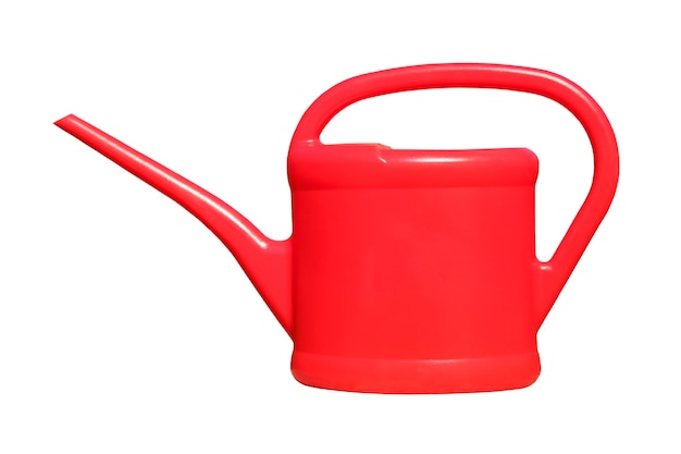 Red plastic garden watering can isolated on white