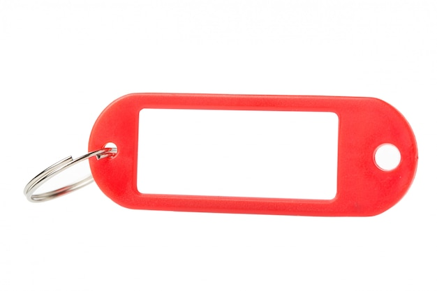 Red plastic key tag or label close up isolated