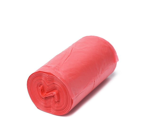 Red plastic trash bags with strings isolated on white surface, close up