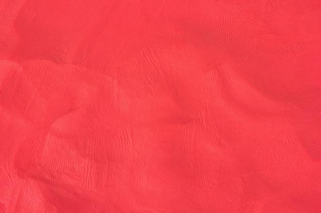 Red plasticine textured background