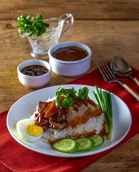 Red pork rice on a wood background
