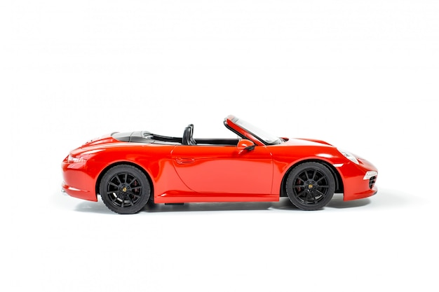 Red porsche carrera s 911 model toy car isolated on white