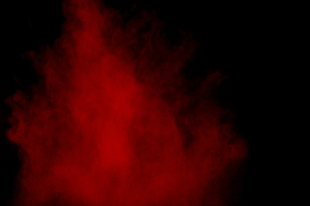 Red powder explosion on black