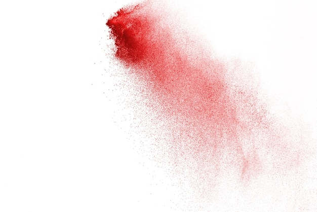 Red powder explosion isolated on white