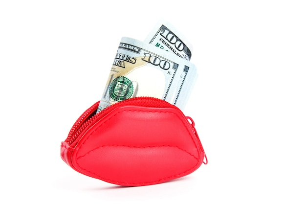Red purse in the form of lips and banknotes of one hundred dollars.