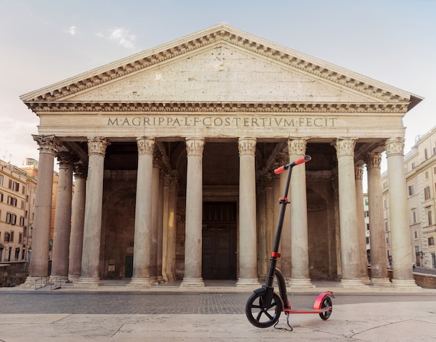 Red push scooters against the backdrop of the pantheon in the roma, italy.