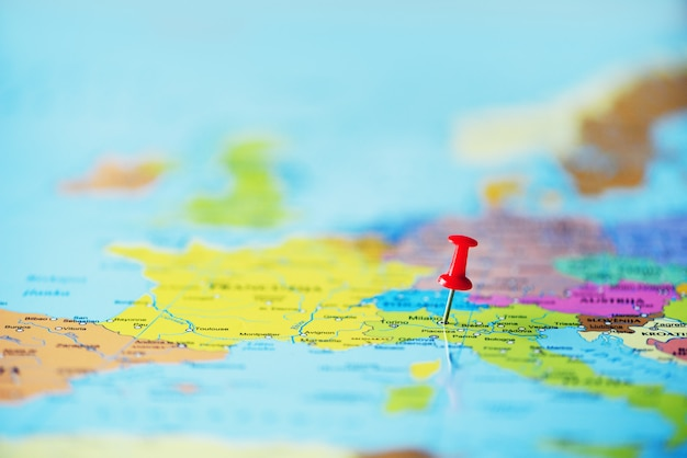 Red pushpin, thumbtack, pin showing the location, travel destination point on map. copy space, lifestyle concept