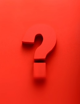 Red question mark on a red background