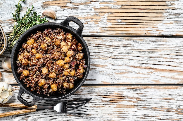 Red quinoa salad with chickpeas and thyme. super food. white background. top view. copy space.