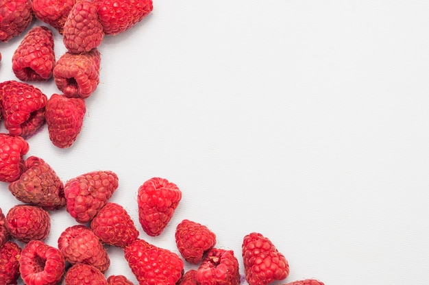 Red raspberries isolated on white background
