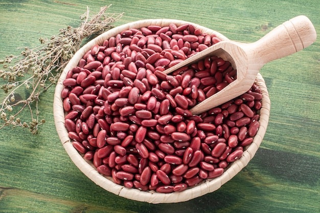 Red raw beans on a green table