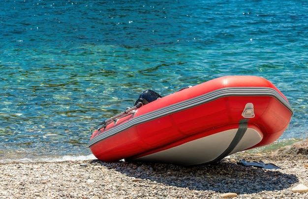 Red rescue inflatable boat, closeup. empty marine rescue boat.
