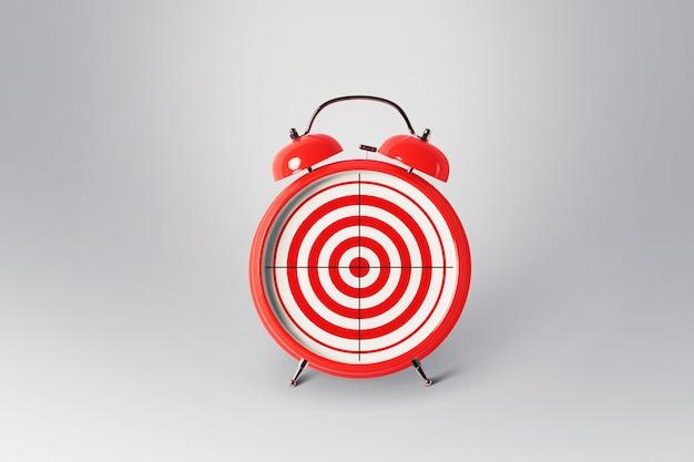 Красный ретро будильник с целью, концепция. креативное представление о времени и успешных целях. отличный управленческий маркетинг и успешный бизнес.