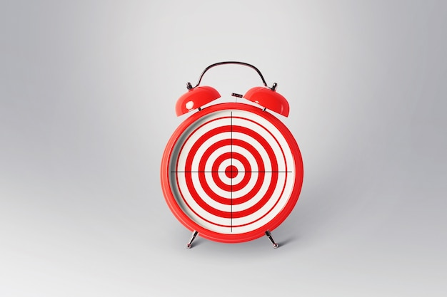 Red retro alarm clock with a target, concept. creative idea of time and successful goals. excellent management marketing and successful business.