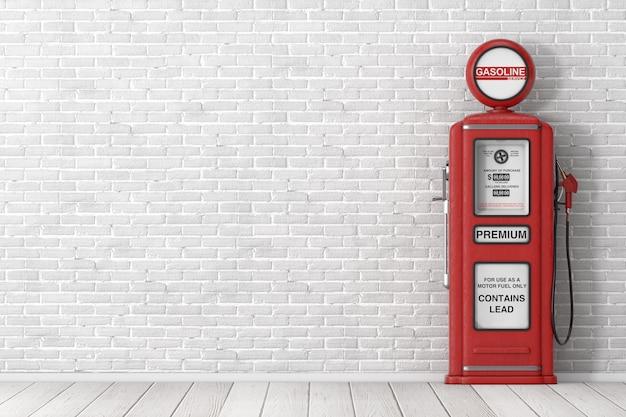 벽돌 벽 앞의 빨간색 복고풍 가스 펌프. 3d 렌더링