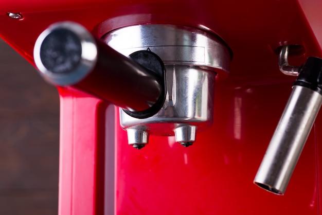 Red retro style coffee machine close up