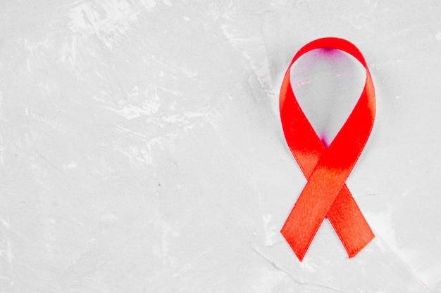 Red ribbon awareness for world aids day concept.