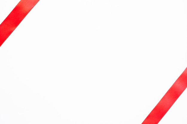 Red ribbon on blank white background