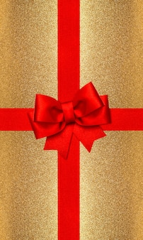 Red ribbon bow on golden background. gift card concept
