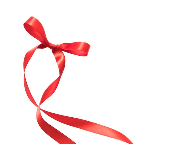 Red ribbon bow isolated on white background with space for your text.
