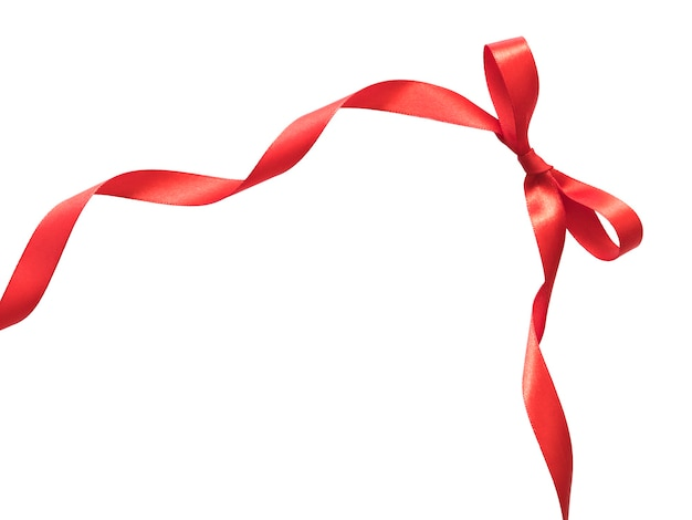 あなたのテキストのためのコピースペースで白の赤いリボンの弓。