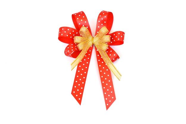 白い点と黄金のリボンの赤いリボンの弓