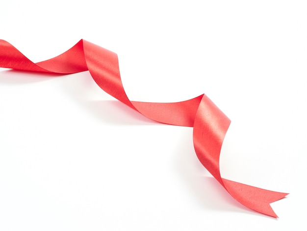 Red ribbon curved isolated on white