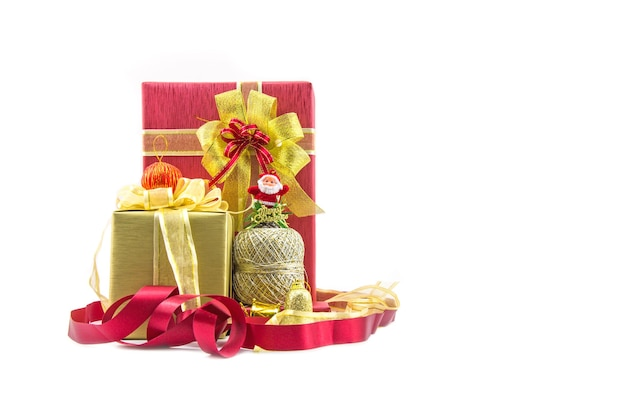 Red and ribbon gold gifts box and decorating elements isolated on white.