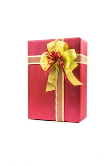 Red and ribbon gold gifts box and decorating elements isolated .