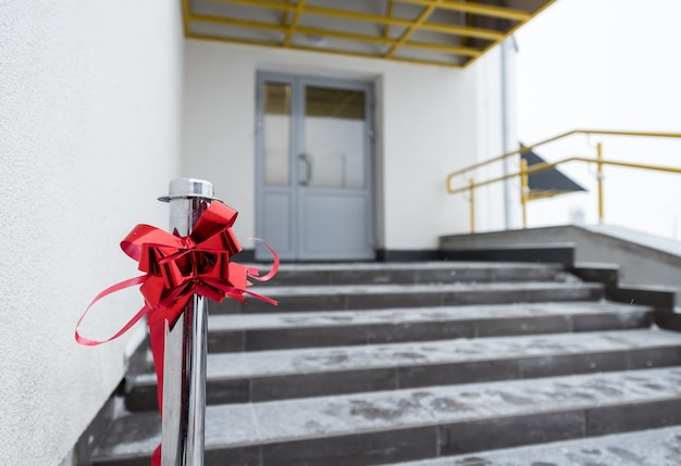 Red ribbon at the opening of the building
