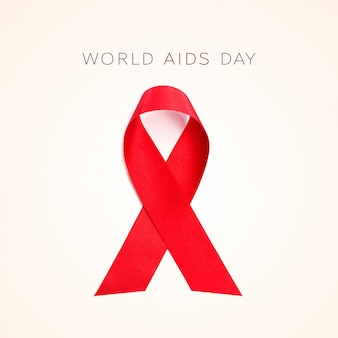 Red ribbon and text world aids day