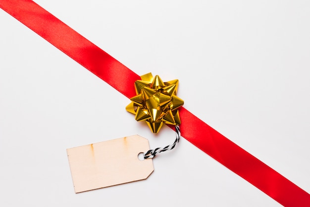 Red ribbon with bow and tag