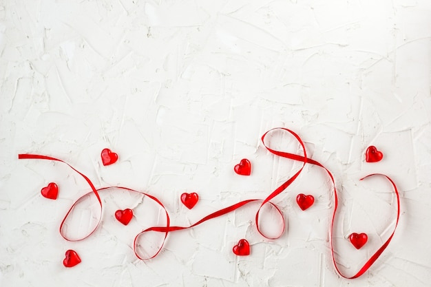 Red ribbon with hearts. to design cards and greetings for valentines day. top view with copy space