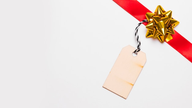 Red ribbon with small paper