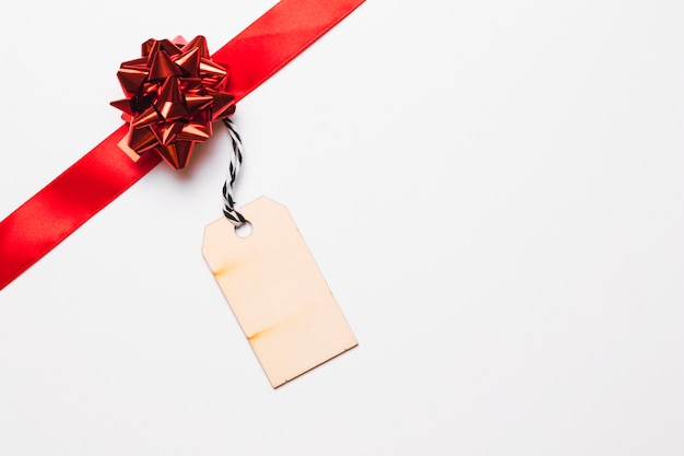 Red ribbon with small tag