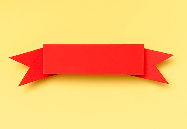 Red ribbon on yellow background