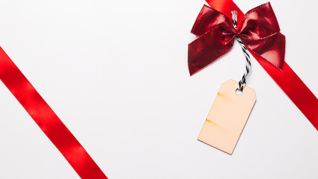 Red ribbons with bright bow and tag