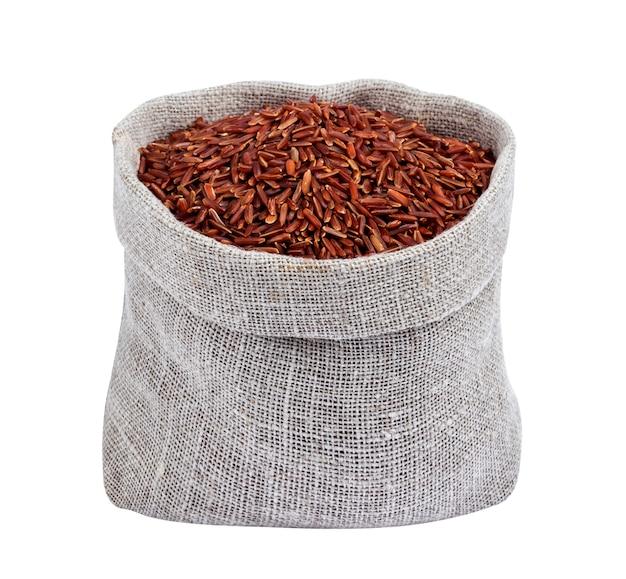 흰색 배경에 고립 된 가방에 빨간 쌀