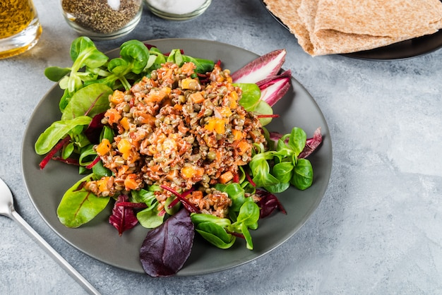 Red rice, lentils and butternut squash with carrot and quinoa in
