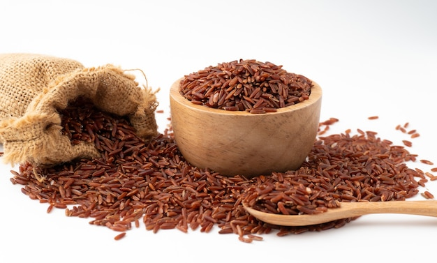 Red rice in a sack isolated
