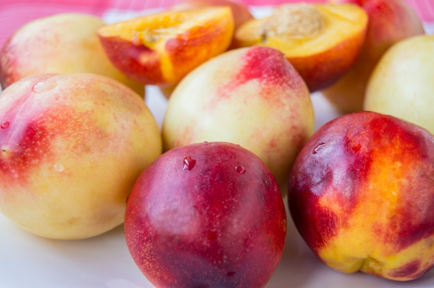 Red ripe nectarine peaches with sliced selective focus