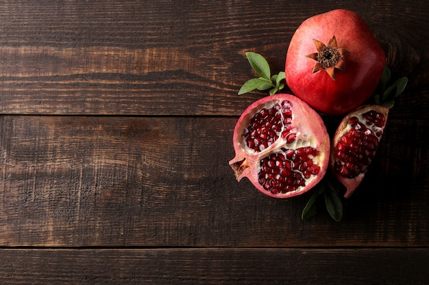 Red ripe pomegranate on a wooden table