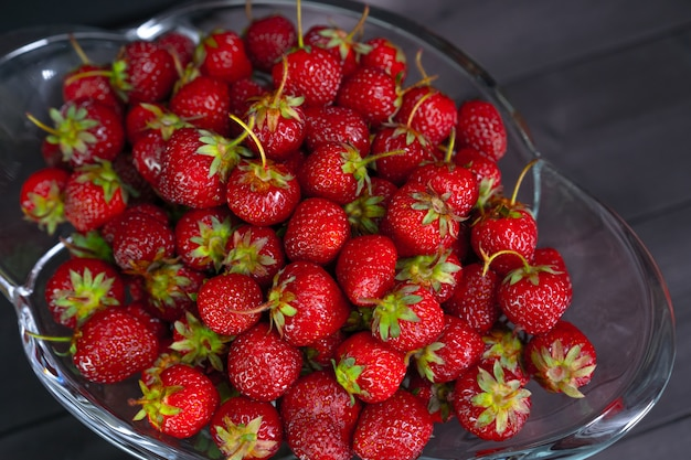 Red ripe strawberries in a vase
