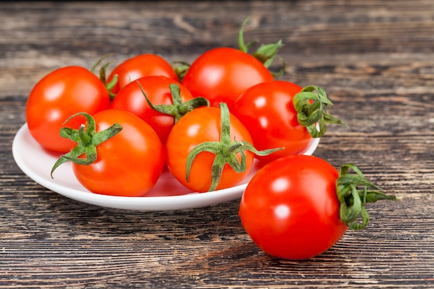 Red ripe tomatoes on a plate