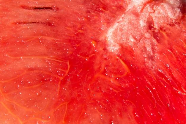 배경에 대한 붉은 익은 수박 과일 질감