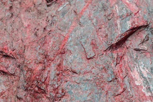 テクスチャ背景の赤い岩層表面