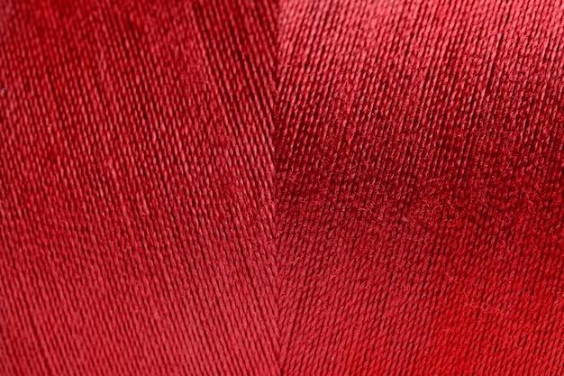 赤い巻き糸のテクスチャの背景